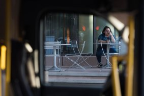 A student sits outside of the Arizona State university Sandra Day O'Connor Law School on Wednesday evening April 12, 2017.