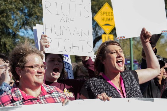 Phoenix Women's March organizer Kristy King (right) leads protesters in a chant before marching through the streets of Phoenix on Saturday morning on Jan. 21, 2017. (Photo by Tynin Fries)