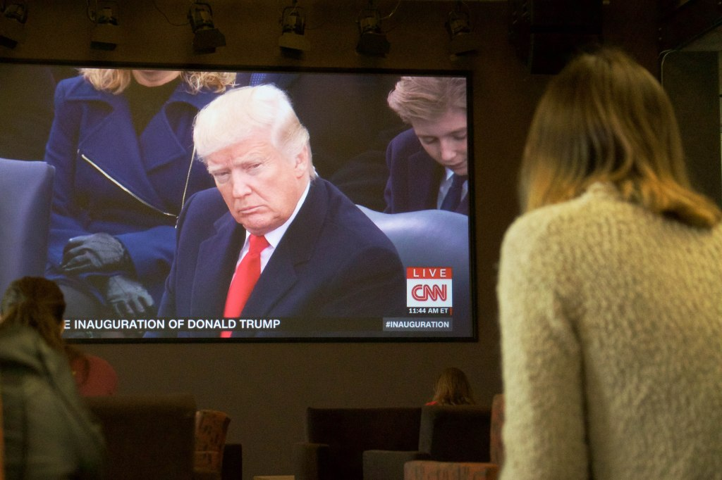 Students watch the presidential inauguration of Donald Trump in the First Amendment Forum on Jan. 20, 2017 in Phoenix, Arizona. (Photo by Tynin Fries)