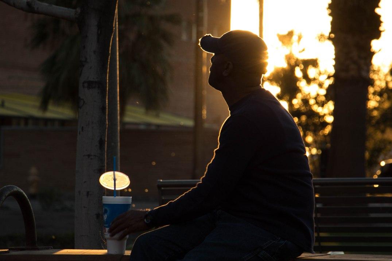 Sam Hughes of San Bernardino, Calif. sits in Civic Space Park Wednesday evening, Feb. 15, 2017. (Photo by Tynin Fries)