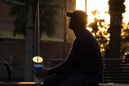 Sam Hughes of San Bernardino, Calif. sits in Civic Space Park Wednesday evening, Feb. 15, 2017. (Photo by Tynin Fries)