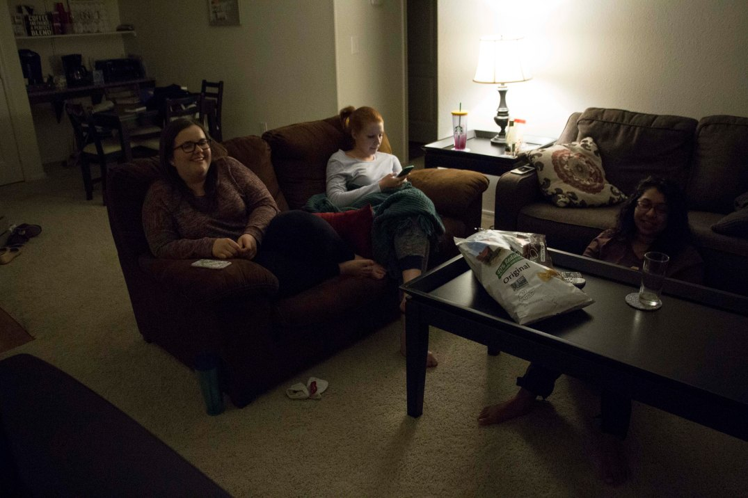 Sophia Horen, left, Natalie Spoehr and Maya Patrose watch a movie together Friday night on Feb. 17, 2017. (Photo by Tynin Fries)
