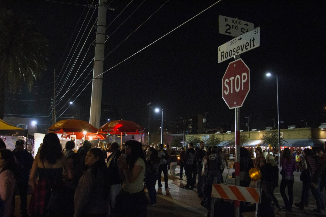 People walk through the First Friday festivities in Downtown Phoenix on Friday, Feb. 3, 2017. (Photo by Tynin Fries)