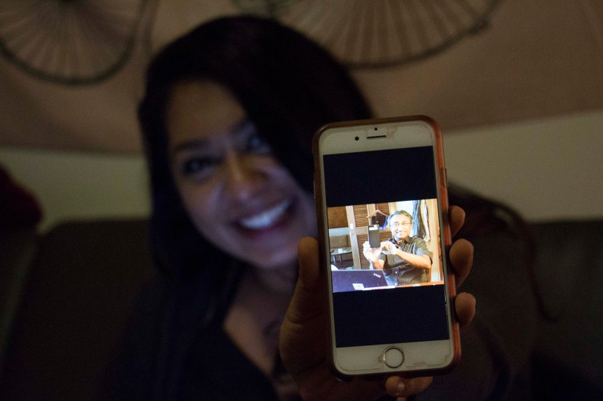 "Maya Patrose, 22, shows off a ""cute"" selfie of her dad, Babu Patrose, Thursday evening on Feb. 9, 2017. (Photo by Tynin Fries)"