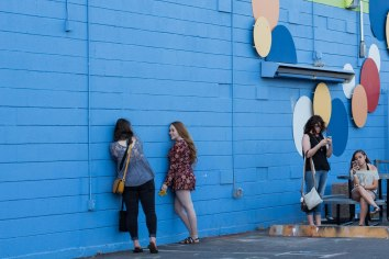 A group of girls takes photos in Downtown Phoenix on March 22, 2017. Photo by Tynin Fries